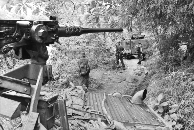Australian_APCs_and_soldiers_during_Operation_Smithfield_in_1966