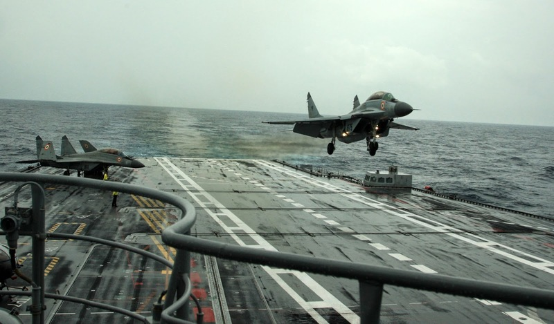 A_MiG-29K_performs_a_touch_and_go_landing_on_INS_Vikramaditya_during_Narendra_Modi's_visit